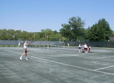 group playing tennis